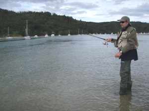 Alan Bulmer tries out his spinning gear on the Whangamata estuary, New Zealand