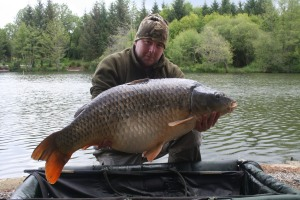 The overhanging tree just above the fishes head in the photo produced this 53lb