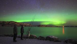 Fishing under the Northern lights