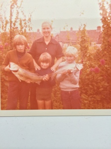 Johns mother, brothers Jim and Justin with a young John on the right 1974