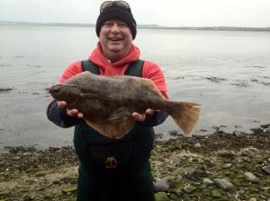 John with a 48cm flounder