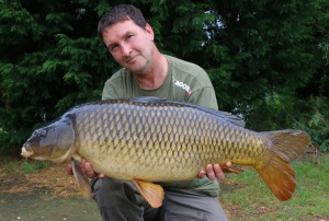 Rob with a beautiful common caught on a 7ft zig