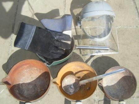 Pots, heavy gloves and mask, the correct gear for lead making