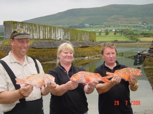 Martin, Sue and Tony with their bluemouth