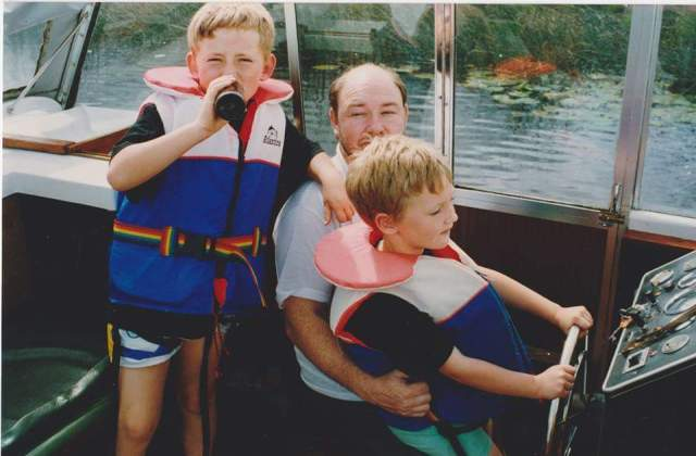 A young Daniel with his Father and brother