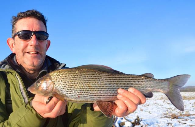 Dai with a fine grayling